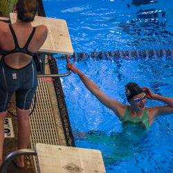 A swimmer celebrates a win at the 3A women's swimming state meet at the South Davis Recreation Center in Bountiful on Saturday, Feb. 13, 2021.