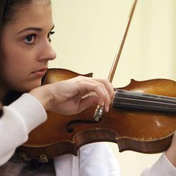 Gifted Music School orchestra student Bree Fotheringham practices in Salt Lake City on April 13.