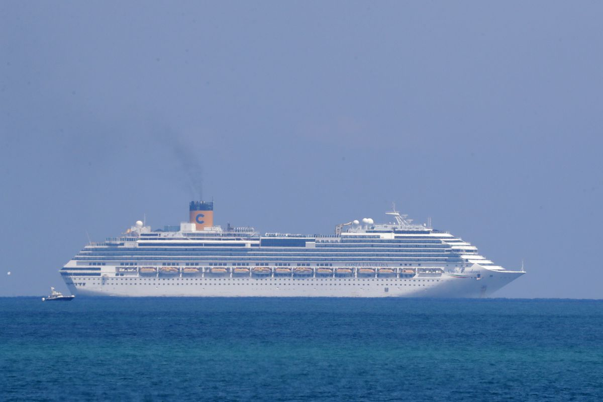 The Costa Cruise ship Favolosa is shown, Thursday, March 26, 2020, off the coast of Miami Beach, Fla. Miami-area hospitals received crew members Thursday from two Costa Cruise ships, the Magica and Favolosa. Carnival Corp., which owns the cruise line, said the ships are empty except for crew members. Carnival said that the ships had tried to dock in several Caribbean ports to get treatment due to the coronavirus for the crew members, but had been turned away. (AP Photo/Wilfredo Lee)