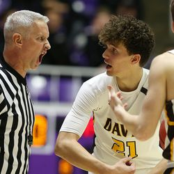 Referee Dennis Nordfelt, left, exchanges words with Davis High's Tyson Garff, middle and Jake Sampson, during action against American Fork in the 6A boys basketball state tournament semifinal action at Weber State's Dee Events Center in Ogden on Friday, March 1, 2019. American Fork won in triple overtime 82-80 to advance to the championship.