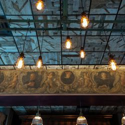 Italian painting above the main bar is over 300 years old. Light fixture is a repurposed meat rack from Manhattan.