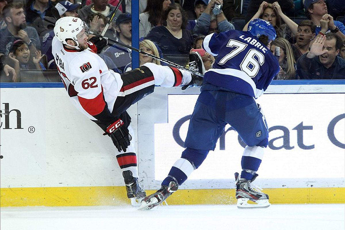 Tampa Bay's Pierre-Cedric Labrie upends Ottawa's Eric Gryba during the Lightning's 3-2 win Tuesday night.