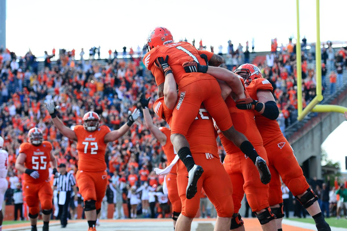 Roger Lewis is hoisted into the air by teammates after catching the game-winning score.
