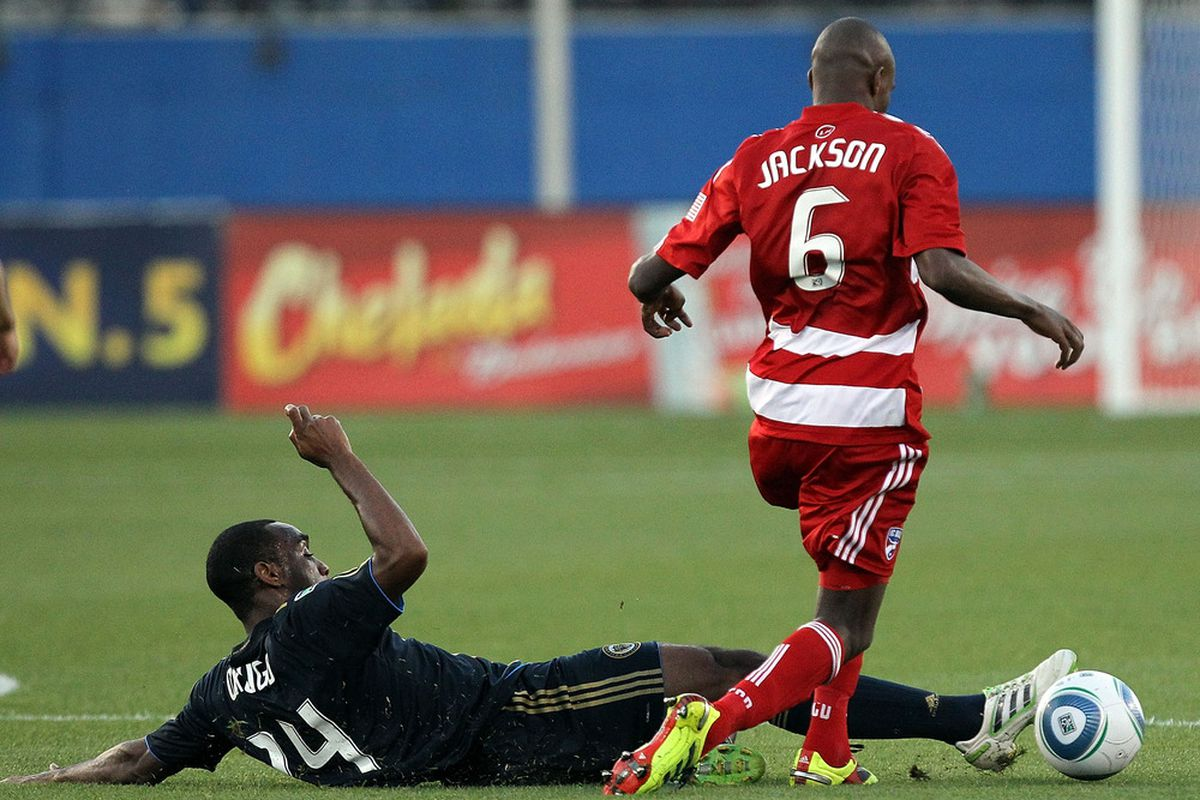 FRISCO, TX - MAY 14:  Jackson Goncalves #6 of FC Dallas dribbles the ball past Amobi Okugo #24 of Philadelphia Union at Pizza Hut Park on May 14, 2011 in Frisco, Texas.  (Photo by Ronald Martinez/Getty Images)