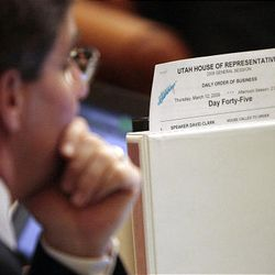 The final daily order of business report sits on the desk of Rep. Ben Ferry, R-Corinne, during the final hours of the 2009 Utah Legislature Thursday.