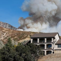 A brush fire burns at the base of Mount Timpanogos in Orem on Saturday, Oct. 17, 2020.
