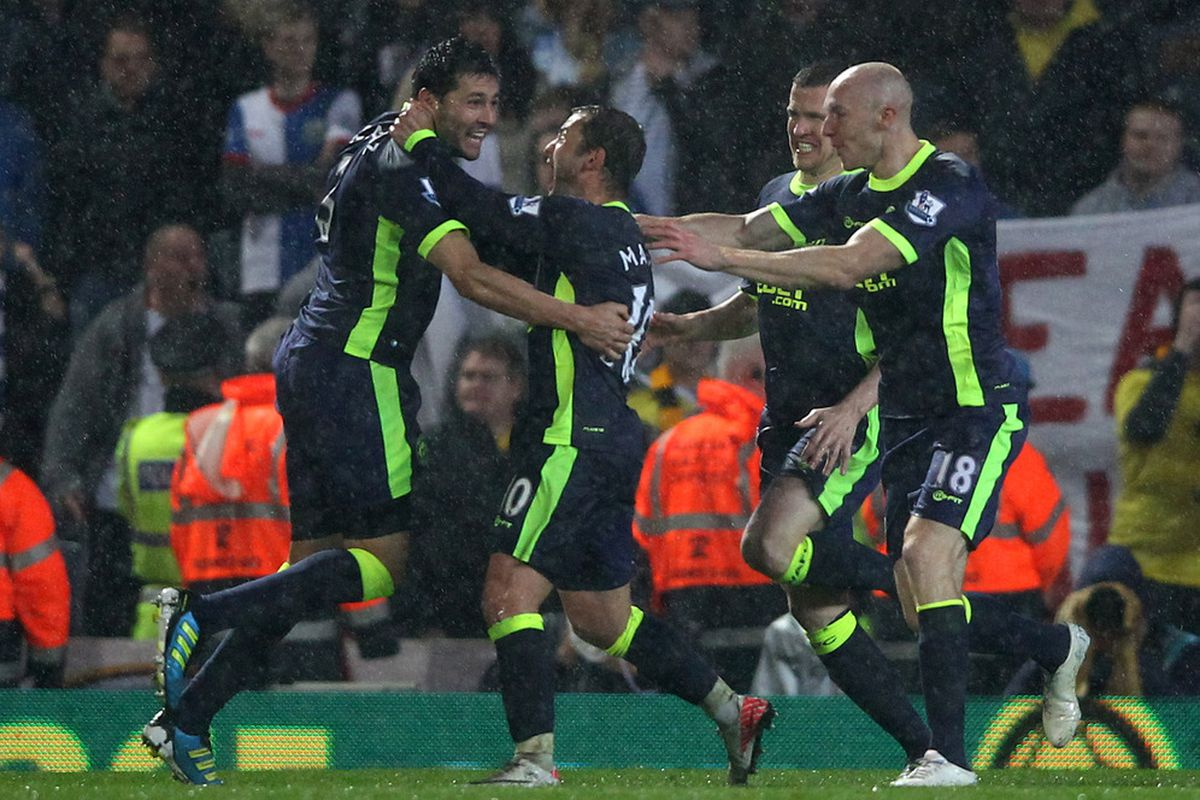 Antolin Alcaraz of Wigan Athletic is mobbed by his team mates after scoring the winning goal during the Barclays Premier League match between Blackburn Rovers and Wigan Athletic at Ewood Park.