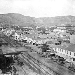 View of Main Street looking north in the mid-1870s. The Great Salt Lake Theater can be seen on the right.