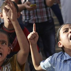 Children of followers of Egyptian Muslim cleric and former candidate for the Egyptian presidency Hazem Abu Ismail chant slogans at a protest in Tahrir Square in  Cairo, Egypt, Thursday, April 26, 2012. Supporters of the former candidate have been protesting for nearly a week, accusing the military of pulling levers to eliminate Abu Ismail and boost support for former regime officials _ particularly former foreign minister and leading presidential candidate Amr Moussa.