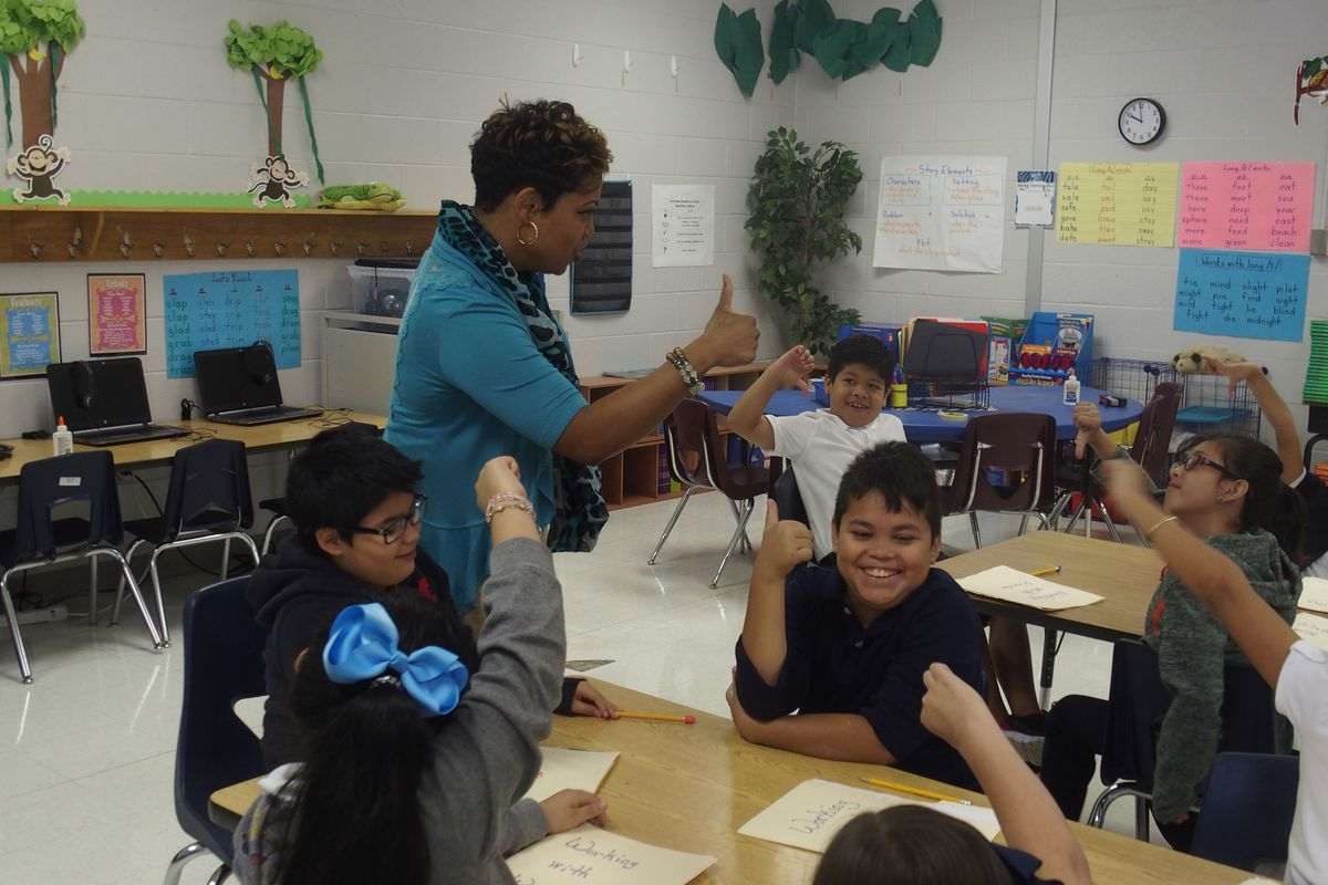 Tanya Hill, an ESL teacher at Kate Bond Elementary School in Memphis, tells her students to respond to a question with a thumbs up or down.