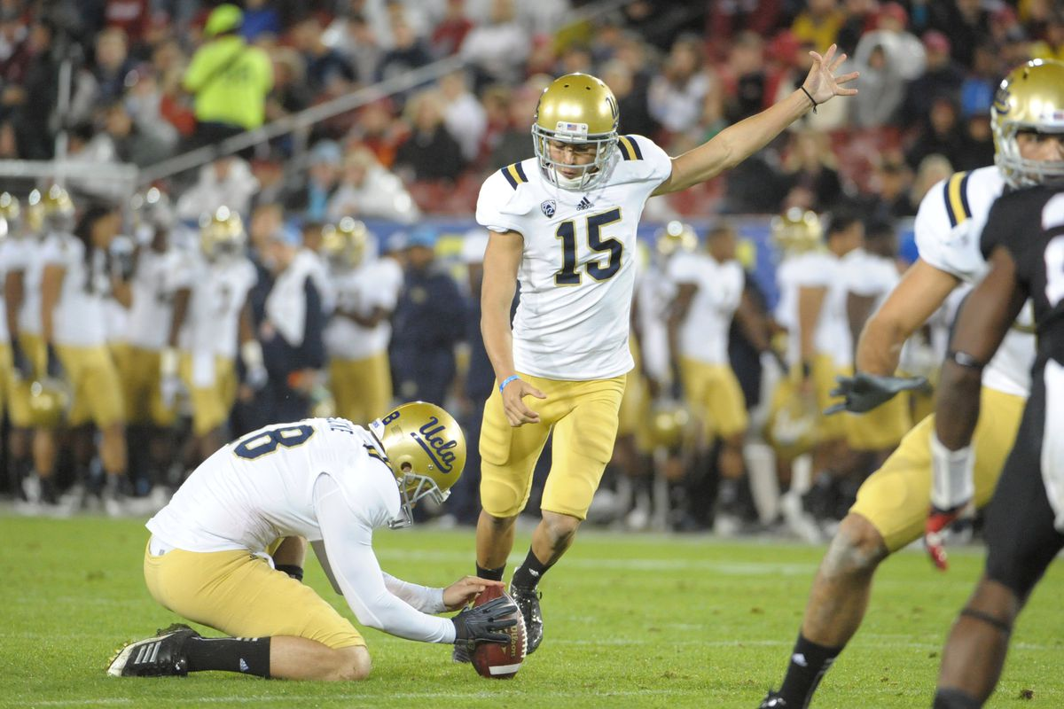 November 30, 2012; Stanford, CA, USA; UCLA Bruins kicker Ka'imi Fairbairn (15) kicks a point-after-touchdown out of the hold by kicker Jeff Locke (18) during the first quarter of the Pac-12 Championship game against the Stanford Cardinal.