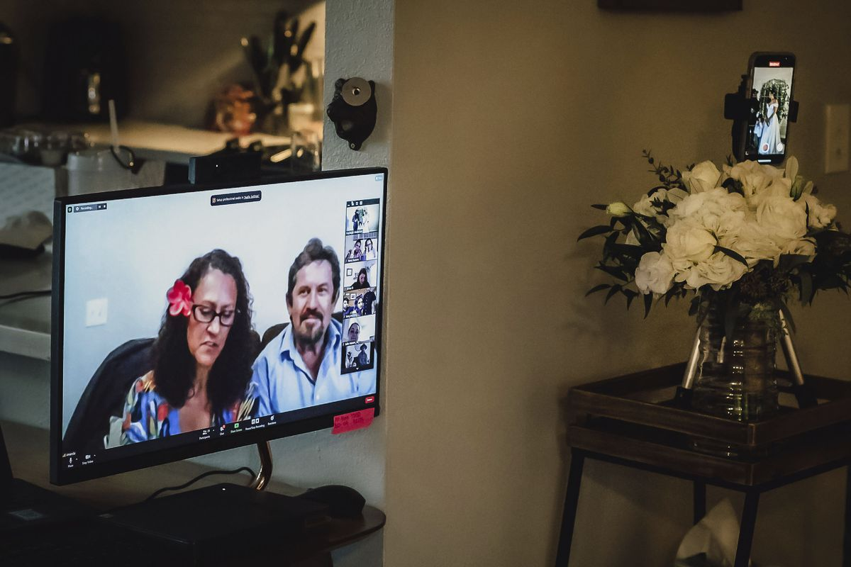 This Sunday, Dec. 27, 2020 photo provided by Kristen Pritchard Photography shows friends and relatives attending on Zoom during Kayleigh and Cody Cousins' wedding in San Diego, California.