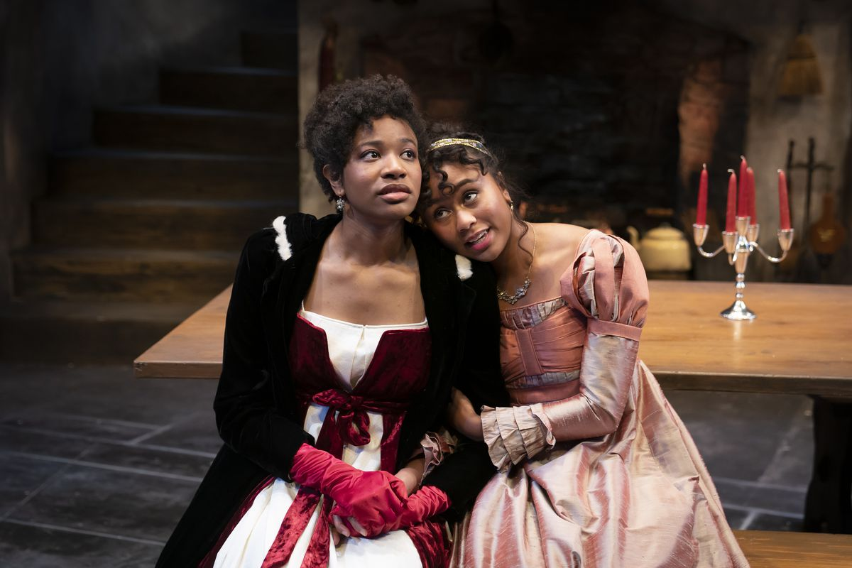 """Jennifer Latimore (left) stars as Lydia Wickham and Netta Walker portrays Elizabeth Darcy in this scene from Northlight Theatre'sworld premiere of """"The Wickhams: Christmas at Pemberley."""""""