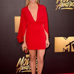 Brittany Snow wears a red Haney minidress.