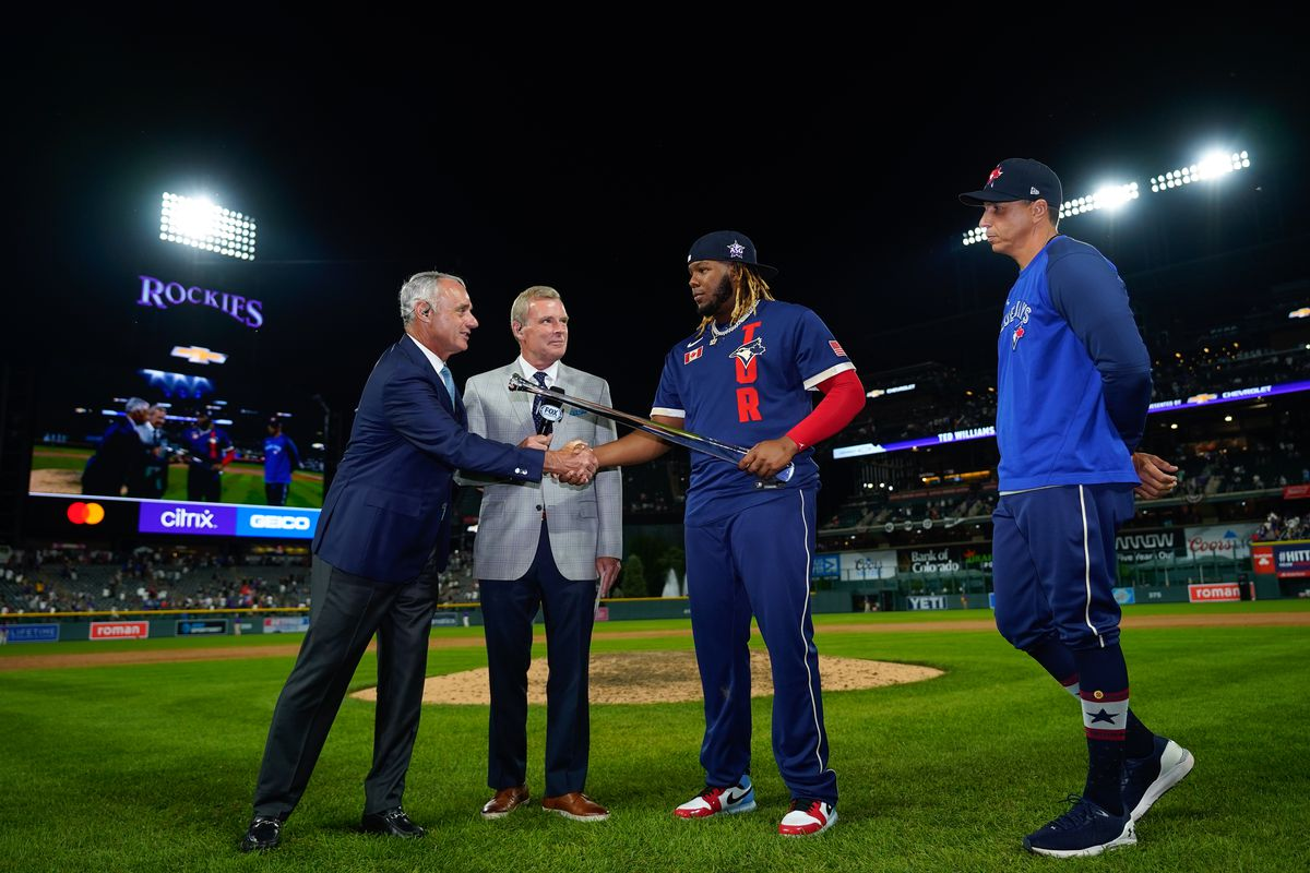 Commissioner of baseball Robert D. Manfred Jr. presents American League All-Star Vladimir Guerrero Jr. #27 of the Toronto Blue Jays with the MVP trophy following the 91st MLB All-Star Game