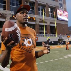 Oklahoma City Thunder's Kevin Durant, who attended the University of Texas, tosses a football around on the sidelines during the first quarter of an NCAA college football game between Oklahoma State and Texas in Stillwater, Okla., Saturday, Sept. 29, 2012.