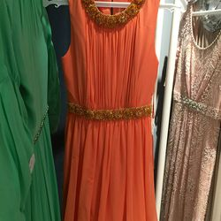 Orange dress, $1,500