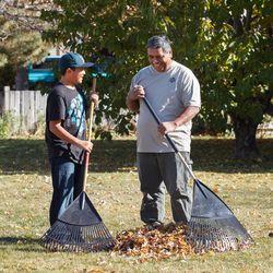 Wayne Wayas and grandson Tyler rake leaves Nov. 14, 2011.