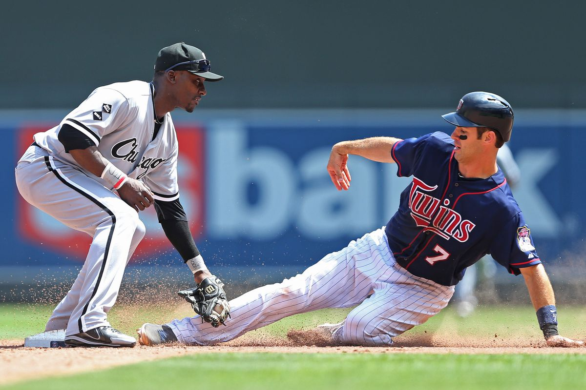 Aug 1, 2012; Minneapolis, MN, USA: Chicago White Sox second baseman Orlando Hudson (5) tags out Minnesota Twins catcher Joe Mauer (7) trying to steal in the sixth inning at Target Field. Mandatory Credit: Jesse Johnson-US PRESSWIRE