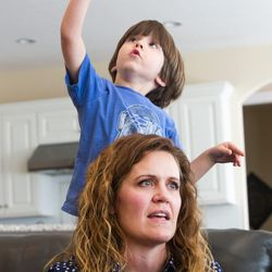 Heidi Wallis is pictured with her youngest son, Louie, who shares a rare disease — guanidinoacetate methyltransferase (GAMT) deficiency — with his sister, Sam, during an interview at their home in Bluffdale on Wednesday, Nov. 2, 2016. Heidi Wallis and her husband, Trey, are fighting to have GAMT screening placed on the national newborn screening list.