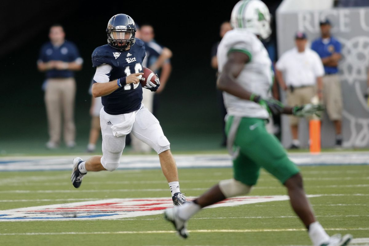 Sep 22, 2012; College Station, TX, USA; Rice Owls quarterback Taylor McHargue (16) runs the ball against the Marshall Thundering Herd in the fourth quarter at Rice Stadium. Mandatory Credit: Brett Davis-US PRESSWIRE
