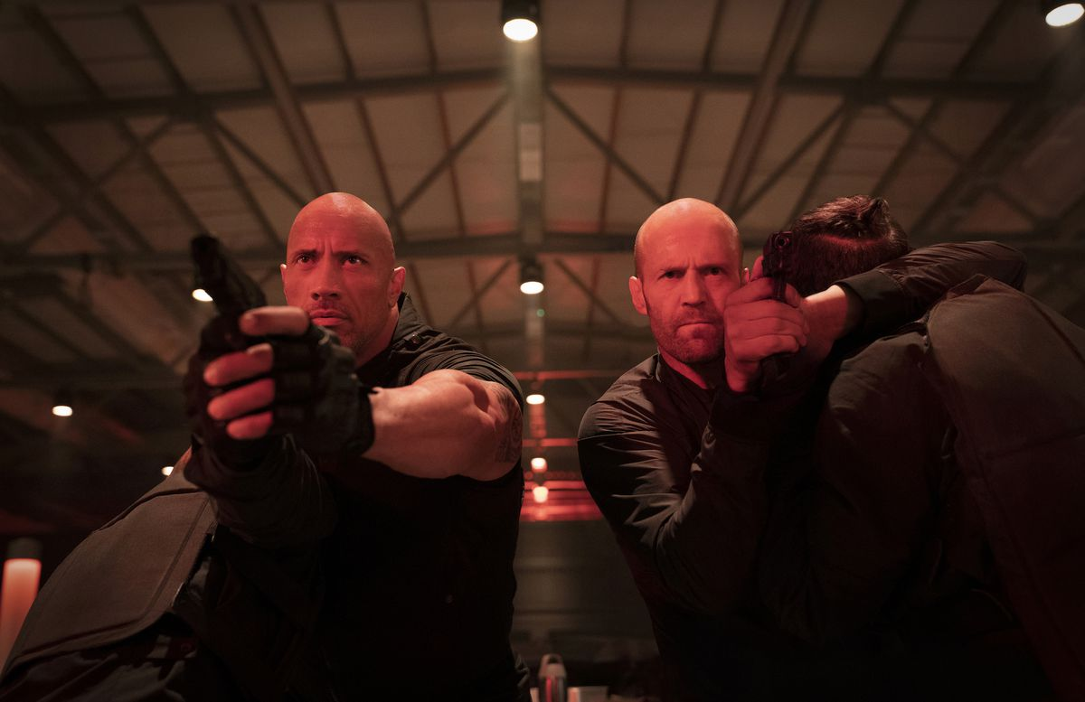 hobbs & shaw take out two goons while cocking their pistols