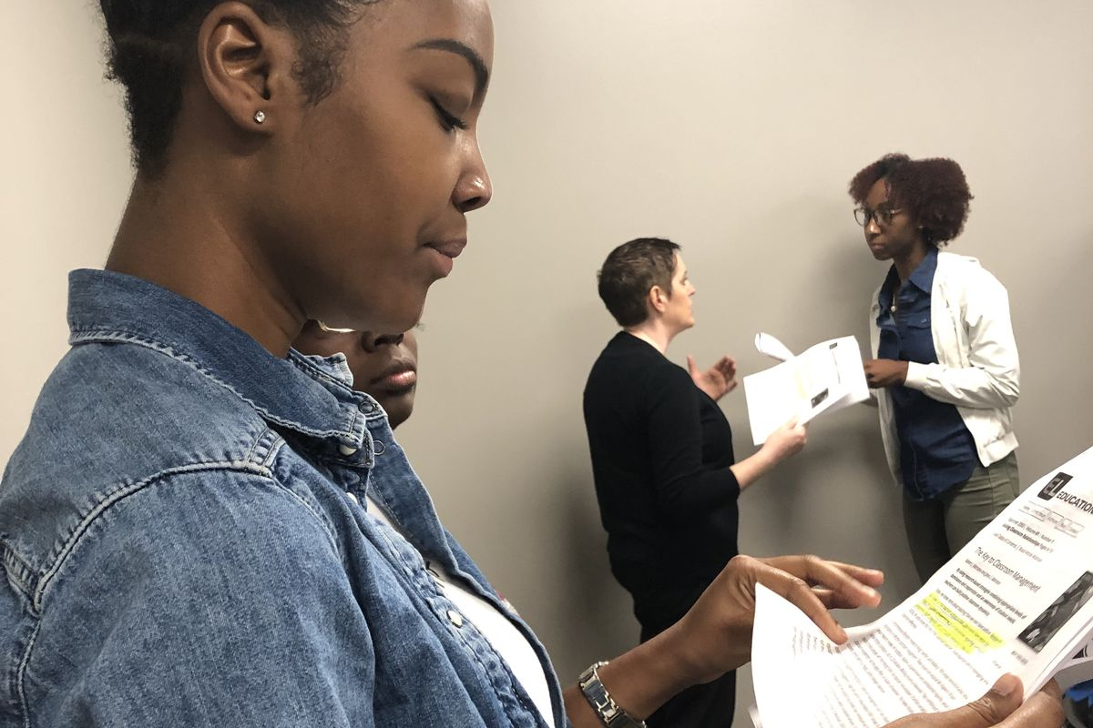 New Craigmont Middle School teacher Paige Williams looks over material on classroom management during a two-day Shelby County Schools orientation event on Aug. 1, 2019.
