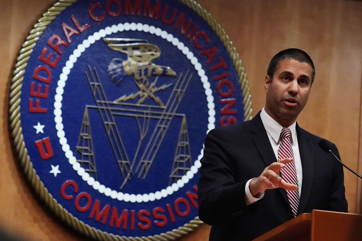 FCC Chairman Ajit Pai stands at a podium in front of the Federal Communications Commission plaque