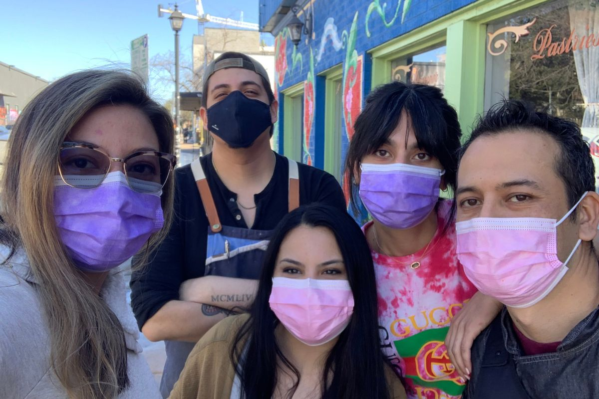 The Buenos Aires Cafe staff with masks