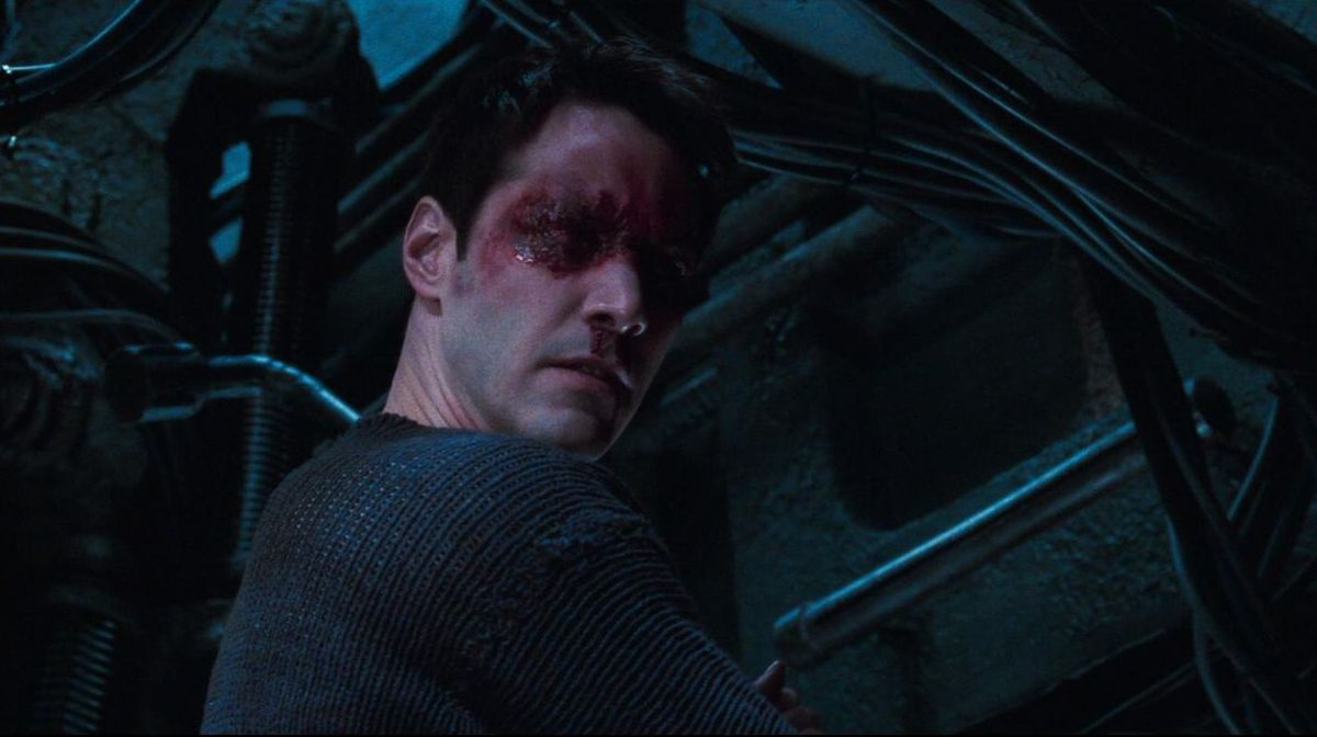 Neo (Keanu Reeves) blinded with burn marks in The Matrix Revolutions
