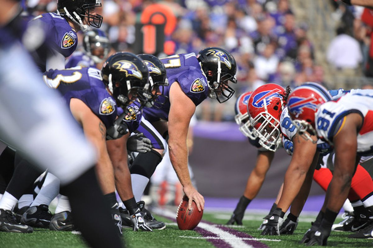 BALTIMORE MD - OCTOBER 24:  Matt Birk #77 of the Baltimore Ravens snaps the ball against the Buffalo Bills at M&T Bank Stadium on October 24 2010 in Baltimore Maryland. The Ravens defeated the Bills 37-34. (Photo by Larry French/Getty Images)