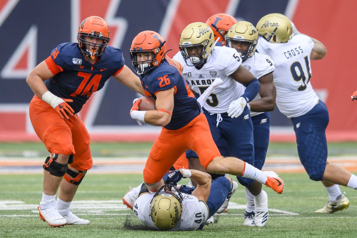 Illinois Fighting Illini running back Mike Epstein runs the ball against the Akron Zips during the second half at Memorial Stadium. Mandatory Credit: Patrick Gorski