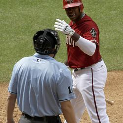 Arizona Diamondbacks' Justin Upton argues with umpire Mike DiMuro after being called out on strikes during the sixth inning in an MLB baseball game against the San Francisco Giants Sunday, April 8, 2012, in Phoenix.