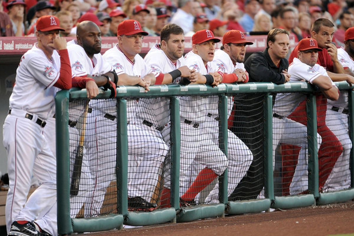 ANAHEIM CA - JULY 26:  The Los Angeles Angels look on from the bench against the Boston Red Sox during the first inning at Angel Stadium on July 26 2010 in Anaheim California.  (Photo by Harry How/Getty Images)
