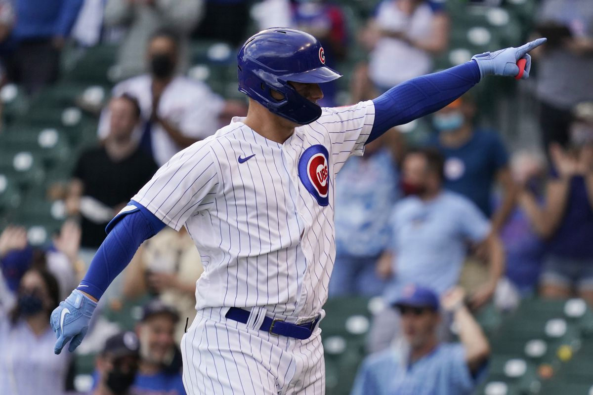 Joc Pederson points to the Cubs dugout after hitting a solo home run in the eighth inning — his first hit of the season after starting 0-for-15 — in the Cubs' 4-2, 10-inning loss to the Brewers on Wednesday at Wrigley Field.
