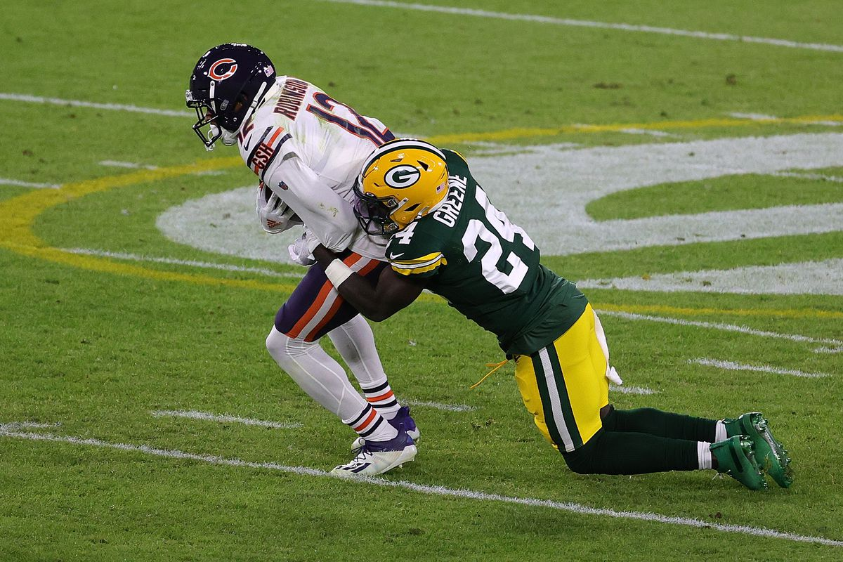 Allen Robinson #12 of the Chicago Bears is brought down by Raven Greene #24 of the Green Bay Packers during a game at Lambeau Field on November 29, 2020 in Green Bay, Wisconsin. The Packers defeated the Bears 45-21.