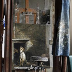 An apron and painting are reflected in a mirror during a preview tour of the home and studio of artist Andrew Wyeth Monday, April 23, 2012 in Chadd's Ford, Pa. The studio will be open for tours in the summer of 2012 by the Brandywine River Museum.