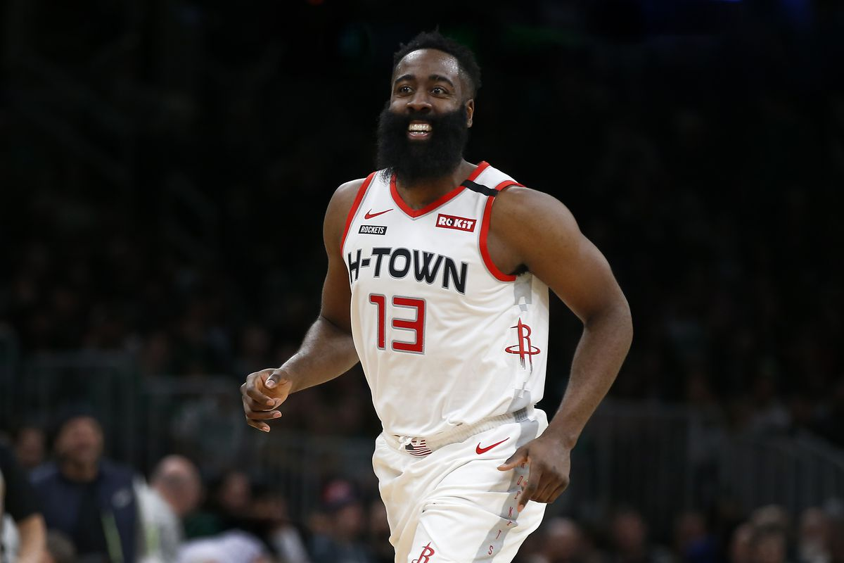 Houston Rockets guard James Harden smiles after scoring against the Boston Celtics during the second half at TD Garden.