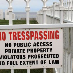 A sing on a fence blocking access to the beach in Long Branch N.J. claims the entry point is only for neighboring property owners, Wednesday, April 18, 2012. But the site is listed as a public access point in a state registry. New Jersey is revising its beach access rules to give local towns more control over where the public can access the coast.