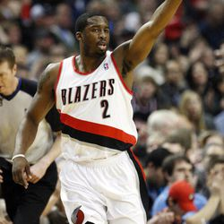 Portland Trail Blazers' Wesley Matthews (2) points downcourt after hitting a 3-pointer in the first quarter of an NBA basketball game against the New Jersey Nets, Wednesday, April 4, 2012, in Portland, Ore.