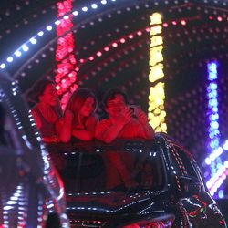 """Isabella Barraco, Bridget Miller and Stefan Todorov take a selfie as they ride through """"Light the RioT,"""" a drive-thru light show, outsideRio Tinto Stadium in Sandy on Monday, May 4, 2020."""