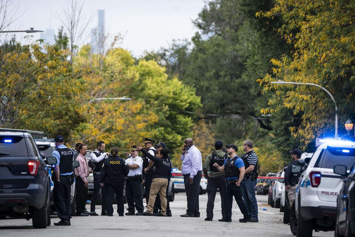 Chicago police investigate after a 14-year-old girl and a security guard were both shot Tuesday afternoon outside Wendell Phillips Academy High School in the 3800 block of South Giles in Bronzeville.
