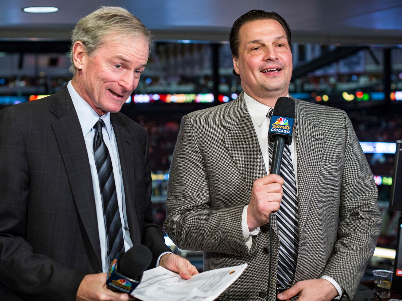 Eddie Olczyk (right) and Pat Foley are calling Blackhawks playoff games together but apart. Foley is in a production truck outside the United Center, and Olczyk is at NBC Sports Network's studios in Stamford, Conn.