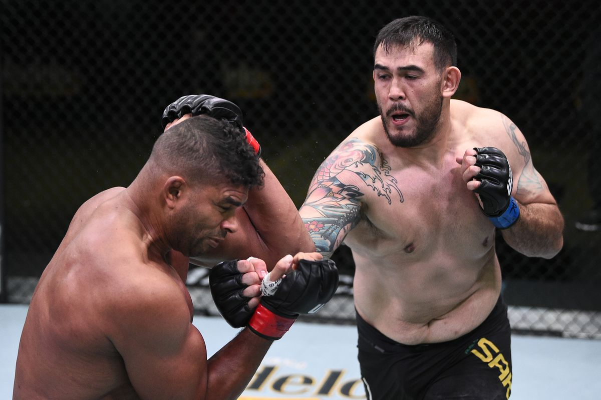 Augusto Sakai of Brazil punches Alistair Overeem of the Netherlands in a heavyweight fight during the UFC Fight Night event at UFC APEX on September 05, 2020 in Las Vegas, Nevada.