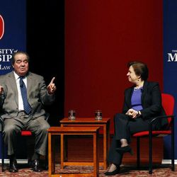 U.S. Supreme Court Justice Antonin Scalia, left, discusses his background as a law student with fellow Justice Elena Kagan Monday, Dec. 15, 2014 at the University of Mississippi in Oxford, Miss. Both justices spoke to an open audience of professionals, professors, students and area residents.