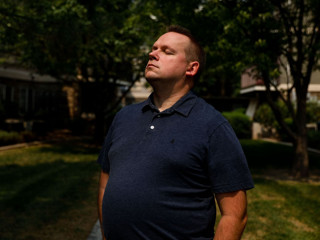 Spencer Casperson closes his eyes while posing for a portraitat his home in Bluffdale on Monday, Aug. 30, 2021.