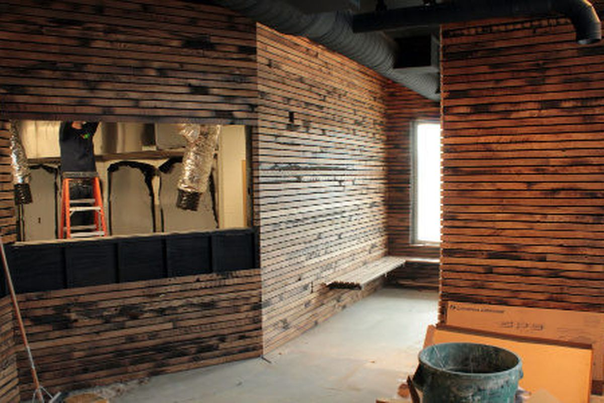 Entry/waiting area. Barn wood slat walls by Dave Puncochar with Good Wood Nashville.