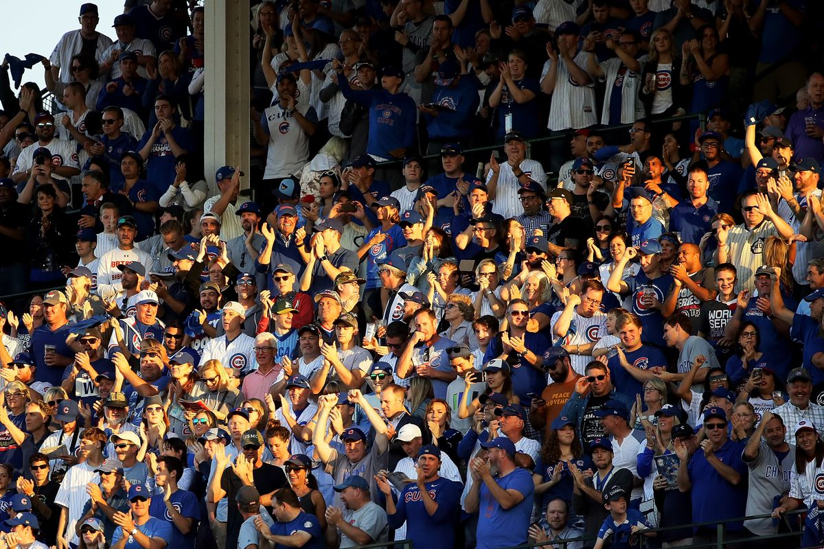 CHICAGO, IL - OCTOBER 09:  Fans cheer in the seventh inning during game three of the National League Division Series between the Washington Nationals and the Chicago Cubs at Wrigley Field on October 9, 2017 in Chicago, Illinois. (Photo by Jonathan Daniel/Getty Images)