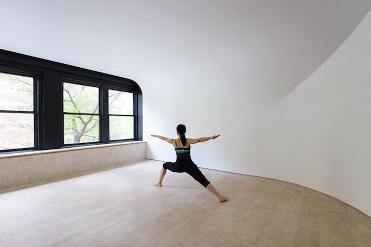 """All photos by <a href=""""http://gionstudio.com/"""">GION</a> via <a href=""""http://www.dezeen.com/2015/05/30/curved-walls-create-illusion-endless-space-yoga-studio-clouds-architecture-office-new-york/"""">Dezeen</a>"""