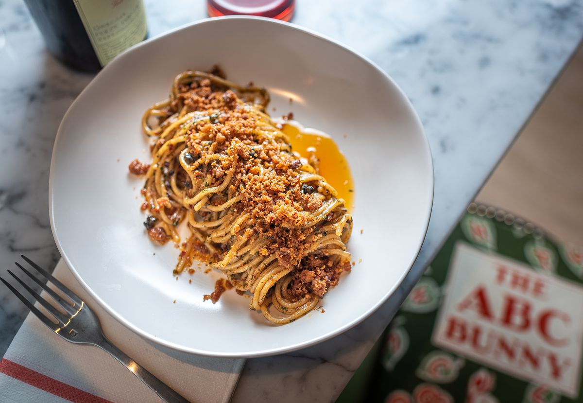 Spaghetti with XO sauce, gremolata, fried capers, and bread crumbs.